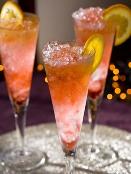 ☆ Liam's Midnight Toast:  A flavorful, colorful and classy cocktail for New Year's Eve:  4 oz. champagne, 1/2 oz. Cognac, 1/2 oz. Grand Marnier, dash of Campari, orange wheel (garnish) and  crushed ice....☆