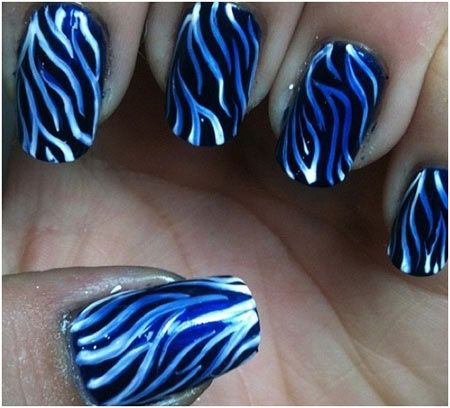 This nail art looks a little tough but it is in-fact quite easy to do. For this just paint your nails black and add zebra stripes with white and blue