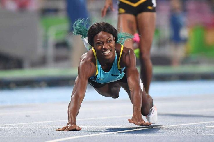8 incredible photos of Shaunae Miller diving to win the 400-meter: August 15, 2016 -