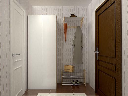 В дизайне всей квартиры преобладает белый цвет. Прихожая – не исключение. Стены здесь белые, мебель также – двухдверный платяной шкаф для верхней одежды, настенная вешалка, дверь в гостиную. Имеется в прихожей и подставка для обуви, каркас которой выполнен из деревянного массива (бамбука), а полки – из нержавеющей стали. Плитка на полу крупная, коричневая и белая.
