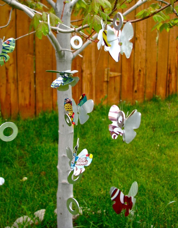 RECYCLED WIND CHIMES - You can make these eye catching wind chimes out of soda cans and washers. They make a light tinkling sound, and the metal shimmers in the sun.