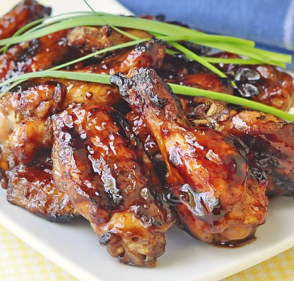 Honey Barbeque Grilled Wings -  serve these as an appetizer at your 4th of July or Canada Day barbeque while the rest of the meal is grilling or slow barbequing. Make lots...believe me you are going to need them. Sweet, spicy, finger-lickin delicious. Pass me another beer!