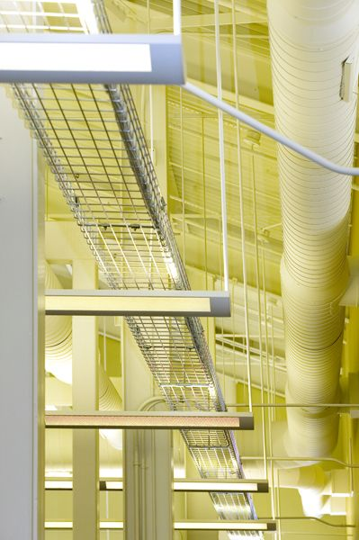 Open Structure, lighting, ductwork, and cable trays are exposed throughout the spaces