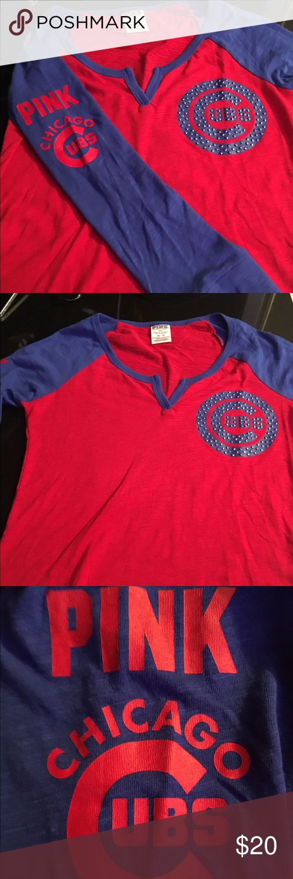Chicago Cubs rhinestone logo top Chicago Cubs top from PINK store , has rhinestones around the Cubs logo , writing on the left arm , & 'cubbies 76' on the back PINK Victoria's Secret Tops Tees - Long Sleeve