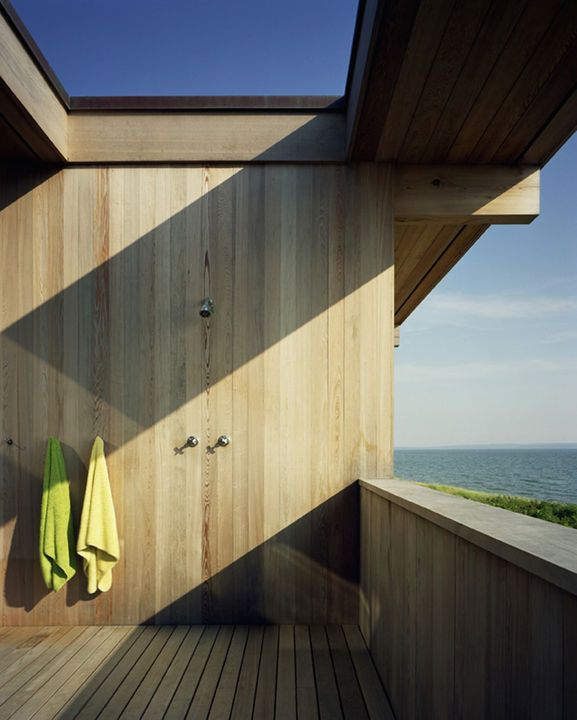 """It lends itself to massive relaxing,"" says architect Cary Tamarkin of his 2,800-square-foot cottage on Shelter Island overlooking Long Island Sound.  ""There's lots of napping, and big dinners on the teak tables out on the porch."" See more of the project here.  Photo by Bart Michiels.   This originally appeared in Shelter Island Retreat."