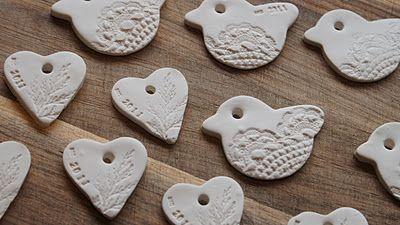 oven baked clay, cookie cutters, pine leaves, doilies and rubber stamps.