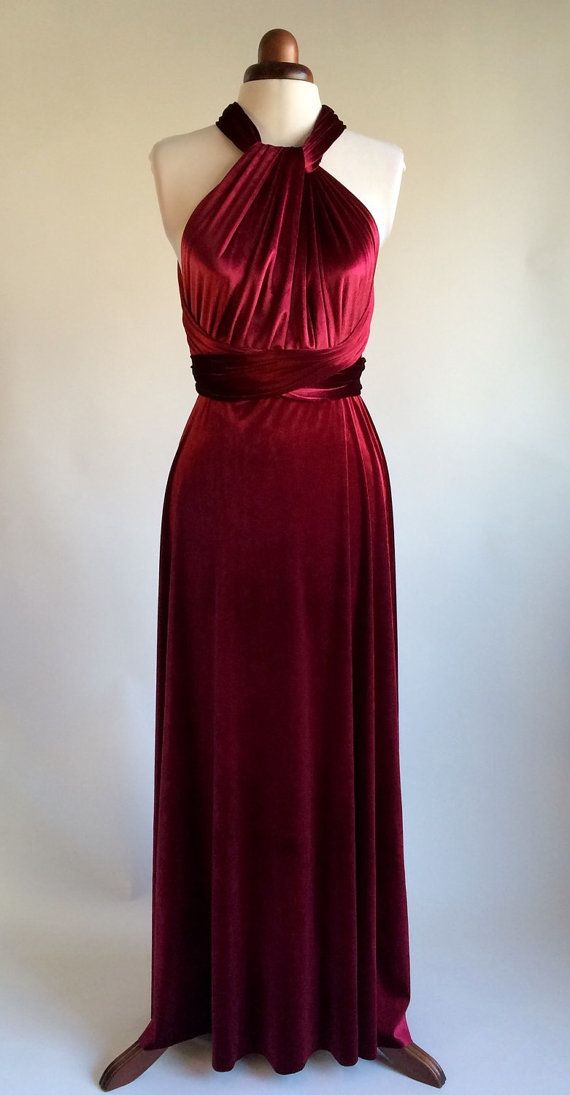 Beautiful infinity dress made in a rich red velvet.  This versatile infinity dress can be worn in more than fifteen different ways by varying the wrapping of the two front vertical bands, with a number of options shown in the photos. It can thus be conservative or daring, and brings glamour to a variety of formal occasions such as balls, proms and dinners, as well as being a popular choice for bridesmaids. It is made with a soft stretch velvet which looks and feels very luxurious.  I…