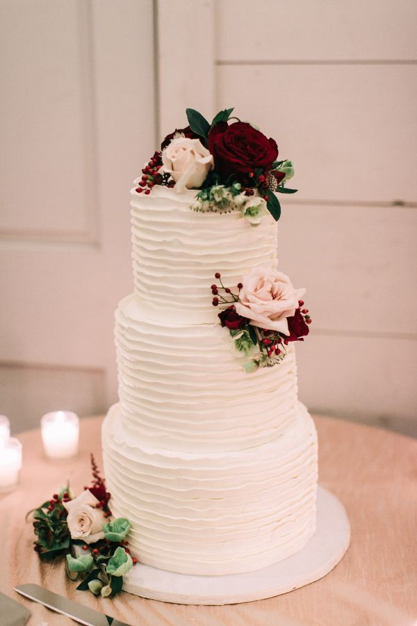 Three tier textured rose topped wedding cake: http://www.stylemepretty.com/2016/11/24/fall-kennebunkport-wedding/ Photography: Emily Delamater - http://emilydelamater.com/