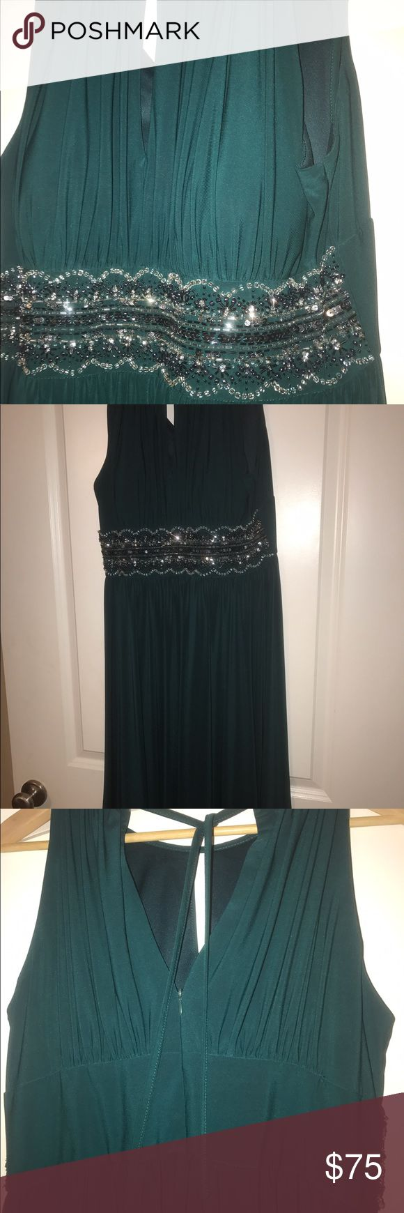 Emerald Christmas Cocktail Dress GORGEOUS keyhole cocktail dress with rhinestone mid. Has cups inside and is fully lined. This dress is one of a kind! Wore it on formal night on a cruise and was told by multiple strangers it was absolutely stunning. Comfortable to wear! I love offers ❤️❤️❤️❤️❤️ Dresses