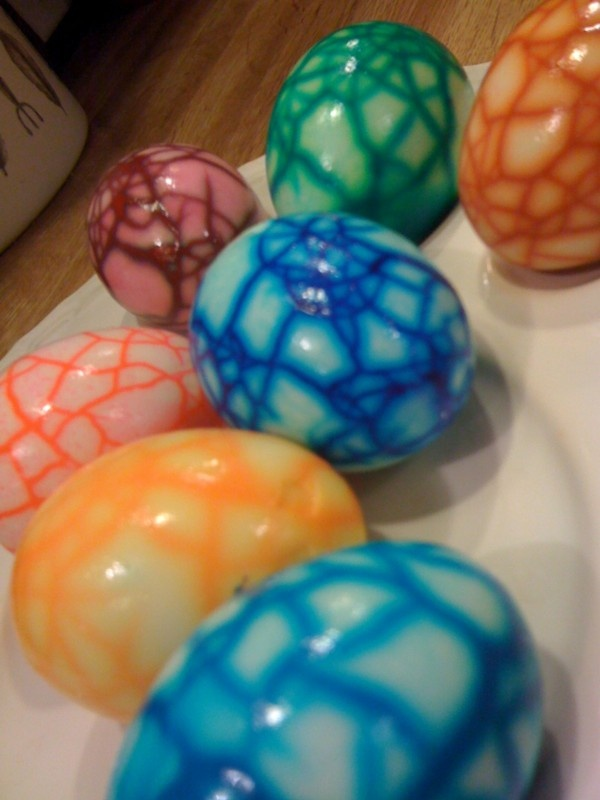 Uber cool dyed Easter eggs.  Why settle for boring?  You MUST use gel food coloring for this method.  Once eggs are hard cooked, gently crack them by rolling them in your hands between a dish towel.  Too many cracks will totally dye the egg; not enough cracks will lead to a boring egg.  Place the cooked and cracked eggs in dye water OVERNIGHT in the refrigerator.  DO NOT let them sit on your kitchen counter or this will be a waste of time and money.  After 12 hours or so, peel the shells and…