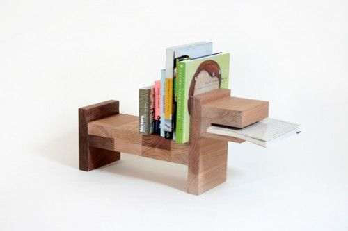 It's a dog! It's so cute! The mouth holds your current book and the back holds all your other favorites!
