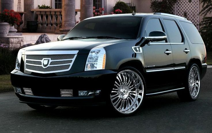 the 2014 Cadillac Escalade will get skinny but tall headlights that run up the hood #Cadillac #luxerycars