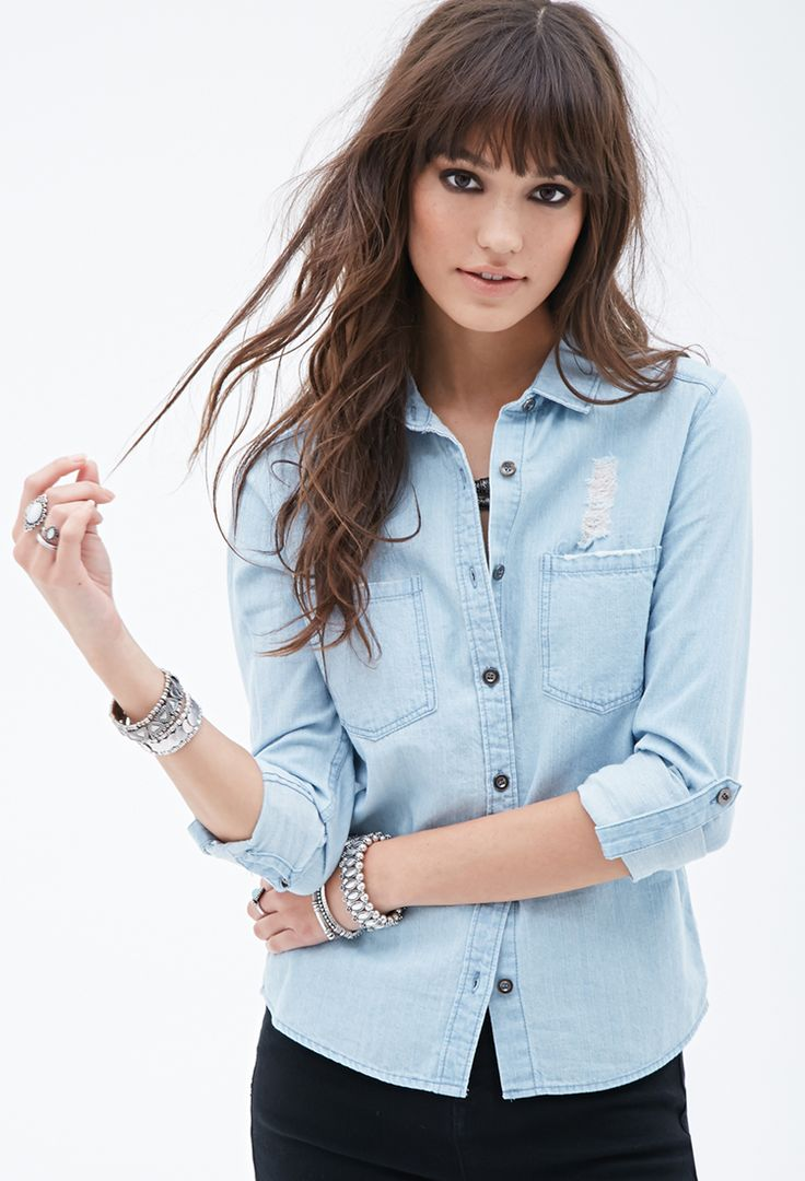 At first glance, this chambray shirt looks like a staple, but unique details set it apart. Starting with the familiar features - a basic collar, button front, and curved hem - it adds artful distressing, bust darts, a Western-style yoke, and roll-tab long sleeves. Totally unique and versatile, this shirt will be on heavy rotation in your closet.