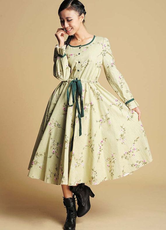 ** Details **  floral Linen fabric  Round neckline with half-button front  Long sleeves with banded ruffled cuffs drawstring waist with contrast ties