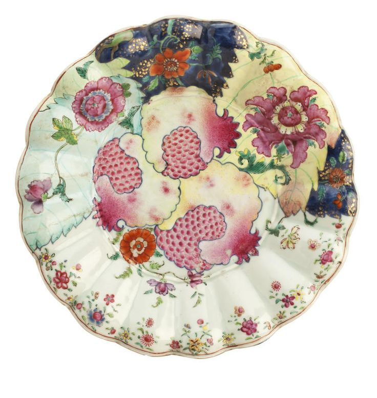 A lobed tobacco leaf tureen stand Mid to late 18th century Three ripe pomegranates fill the central well with the typical multicoloured tobacco leaves around the lower rim, 29cm diameter