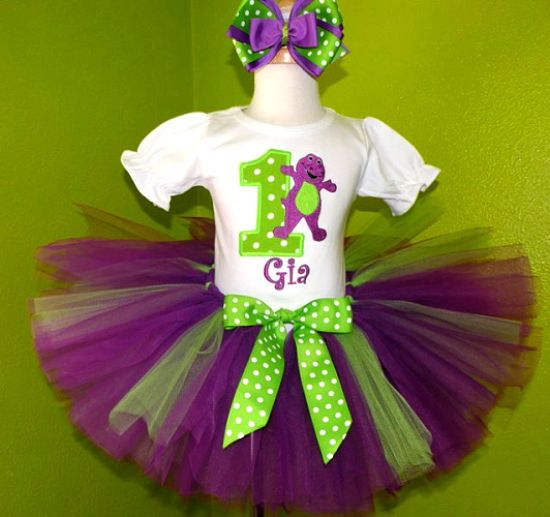 The perfect outfit for your little Barney The Dinosaur fan. Your little one will steal the show when wearing this BARNEY Number Tutu Set! Fun colors and your favorite characters combine to create a wonderful birthday outfit. Add your child\'s name for an added touch! The tutu is full and fluffy. This super cute birthday tutu set will be perfect for your little girls birthday party! The full set includes a personalized onesie or shirt with a 8.5\ tutu and a hair bow on a