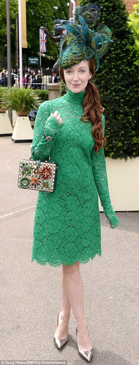 Stardust and Indian Summers actress Olivia Grant looked lovely in a green lace dress with a peacock feather hat