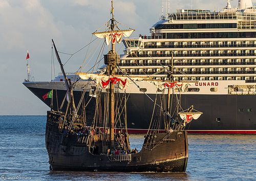 Old and new - Queen Victoria cruise ship and Nau Santa Maria, a replica of Christopher Columbus' caravel. Madeira, Portugal