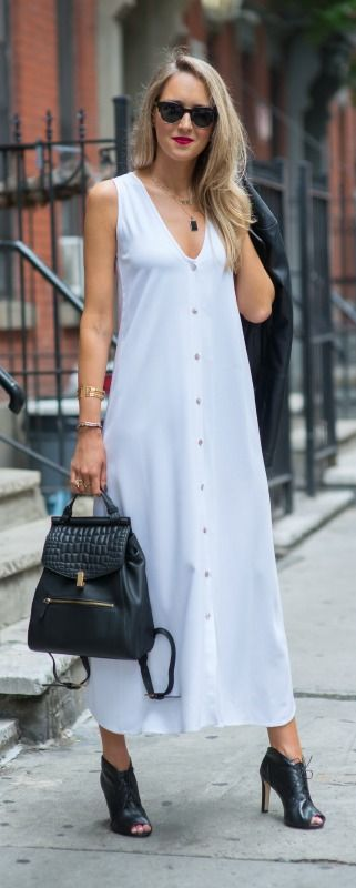 http://www.theclassycubicle.com/2014/09/nyfw-street-style-recap.html | white button front maxi dress, black leather lace up booties, black leather backpack, black leather jacket | new york fashion week street style #ss15 #nyfw
