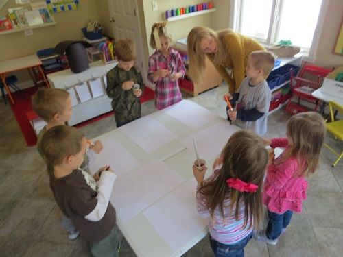 Musical Chairs Art: what a fun activity. Children paint to music. When music stops, children walk around until starts again. Children start painting wherever they are when music starts again.