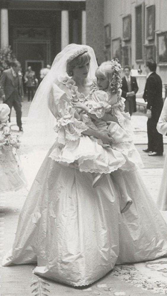 July 29, 1981: Lady Diana Spencer in Saint Paul's Cathedral before her wedding, comforting bridesmaids.