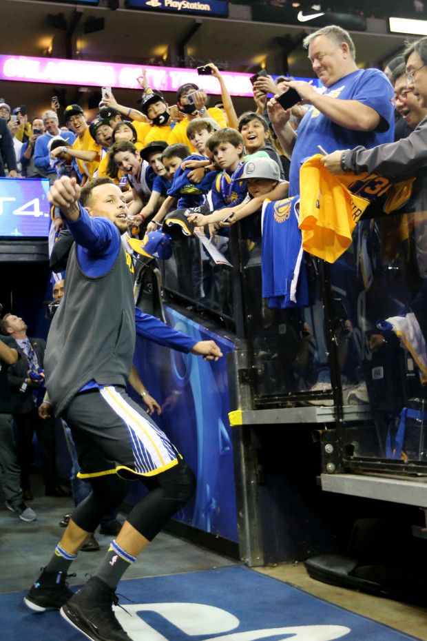 Golden State Warriors' Stephen Curry (30) makes a celebratory dance after making his traditional long basket from the tunnel on his first attempt before the start of the game against the Oklahoma City Thunder at Oracle Arena in Oakland, Calif., on Tuesday, Feb. 6, 2018. (Ray Chavez/Bay Area News Group)