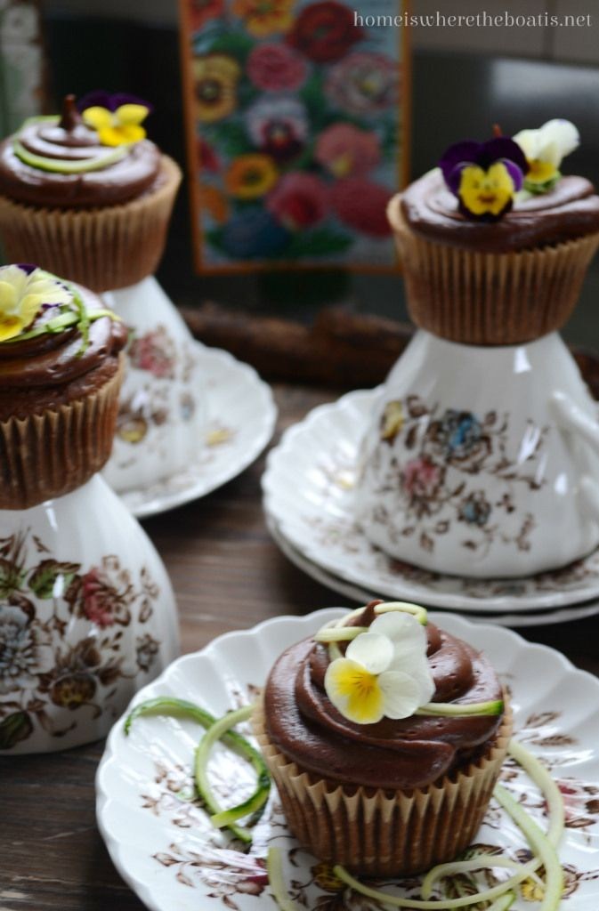 Chocolate Zucchini Cupcakes! The addition of zucchini makes the cupcakes moist and gives you an excuse to eat your veggies. Garnish with an edible viola and zucchini strand. #cupcakes #edibleflowers #zucchini