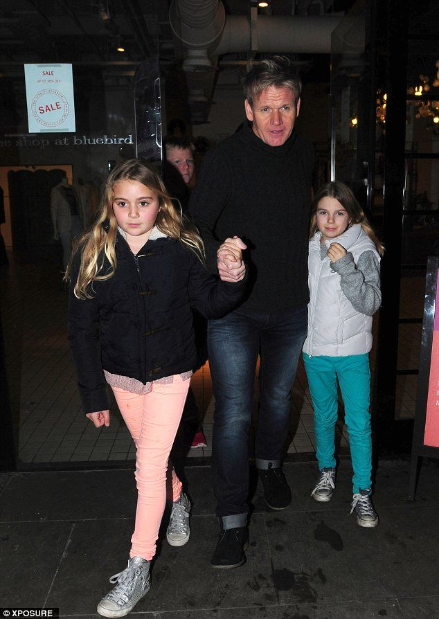 Daddy's girls: Gordon Ramsay holds his daughters hands as they leave a restaurant after a family meal