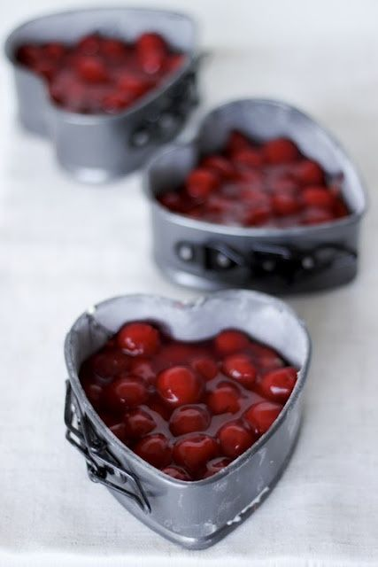 Cherry cheesecakes in heart forms.