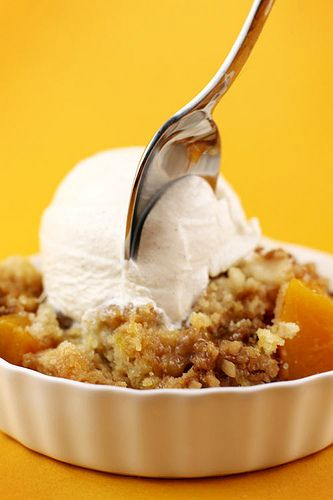 Peach Crunch Cake: quick and easy, just a can of peaches in syrup topped w cake mix, pats of butter, brown sugar & chopped walnuts. yum!