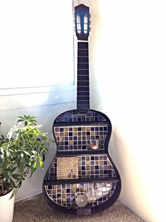 Stunning repurposed guitar shelf with mosaic glass tile backsplash in cobalt blues, black, copper