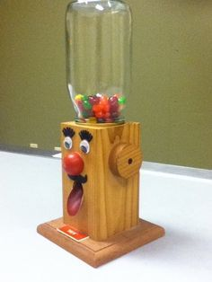 This is my own creation with the help of my dad.  It is an M&M/Skittles/Jelly Bean Dispenser.  Made from Cedar and imagination.