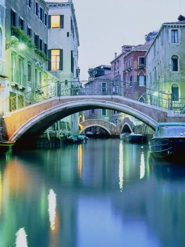 BRIDGE ABOVE A CANAL IN VENICE, EVENING SHOT  Photographic Print|By Guenter Rossenbach