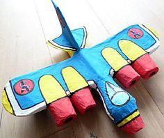 Knippen en plakken. Bouw een vliegtuig op uit karton met papier mache