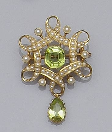 An Edwardian peridot and seed pearl brooch Of hexagonal looped ribbon design, set with seed pearls, around central octagonal step-cut peridot, supporting pear-cut peridot drop below, width 2.5cm.