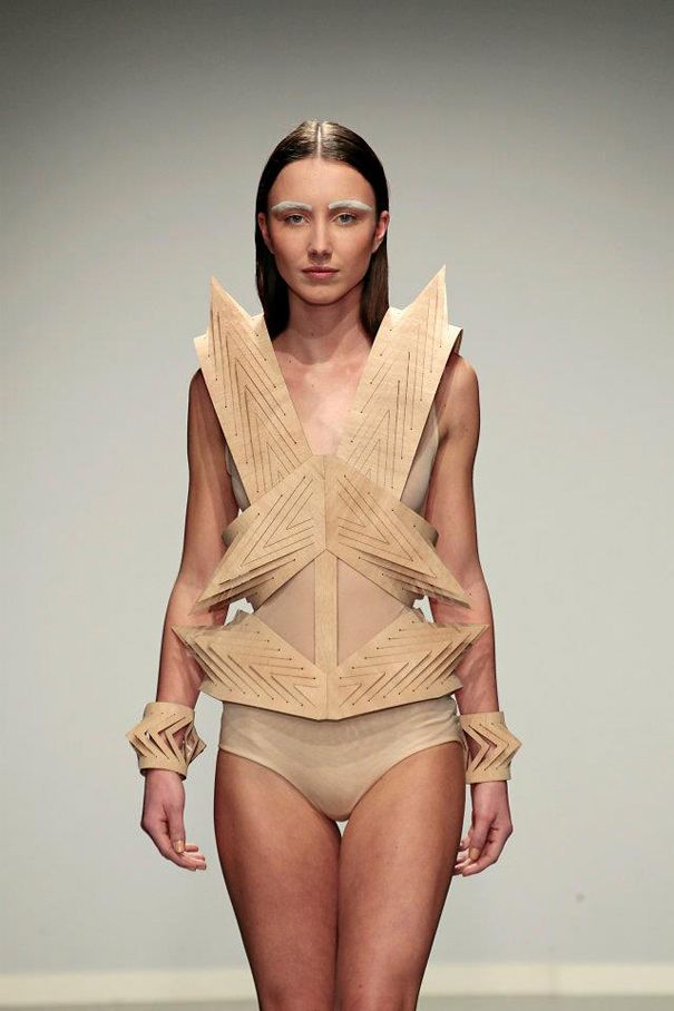 """Amsterdam Fashion Week, fashion designer Winde Rienstra presented her new collection """"Reflections in Facets"""". Silk, wood, cardboard and glass all scrupulously worked and inspired by painter J.C.J. Van Schagen."""