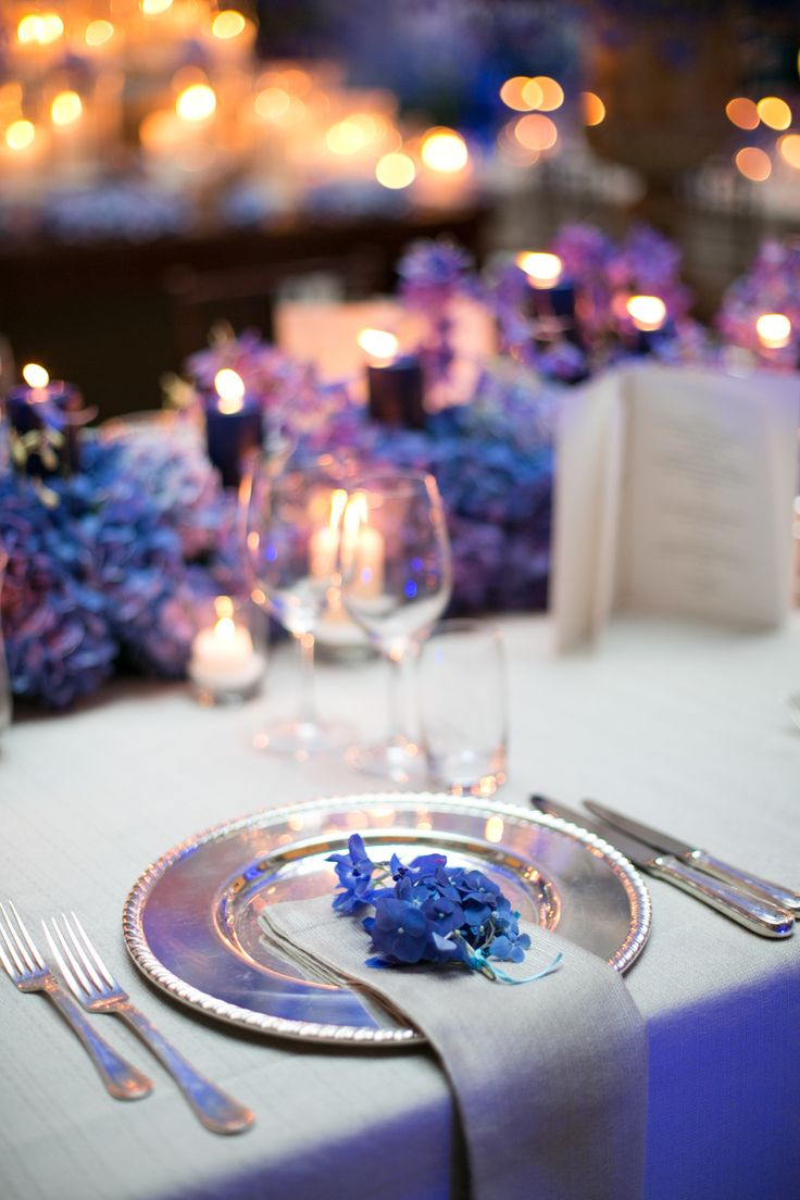 Blue wedding table set up, blue hydrangea, beige tablecloth