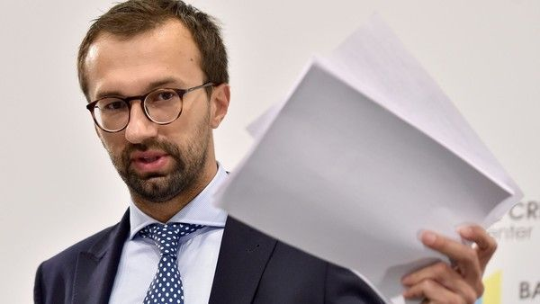 Ukrainian journalist and member of parliament Serhiy Leshchenko holds pages showing allegedly signings of payments to Donald Trump's presidential campaign chairman Paul Manafort from an illegal shadow accounting book of the party of former Ukrainian president Viktor Yanukovych during a press conference in Kiev on August 19, 2016.