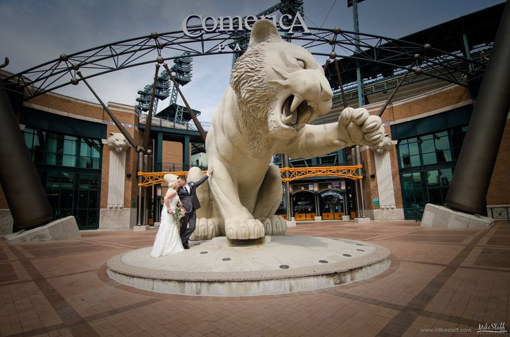 Kissing bride and groom in front of tiger at Comerica Park in Detroit #Michiganwedding #Chicagowedding #MikeStaffProductions #wedding #reception #weddingphotography #weddingdj #weddingvideography #wedding #photos #wedding #pictures #ideas #planning #DJ #photography