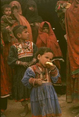 Kuchi children in Afghanistan. The embroidered shirts on these Afghan Kuchis are almost identical to the designs in Katchchh district, Gujarat, India. (via Bob McKerrow - Wayfarer: Kuchi or Kachchi nomads: India, Afghanistan and beyond.)