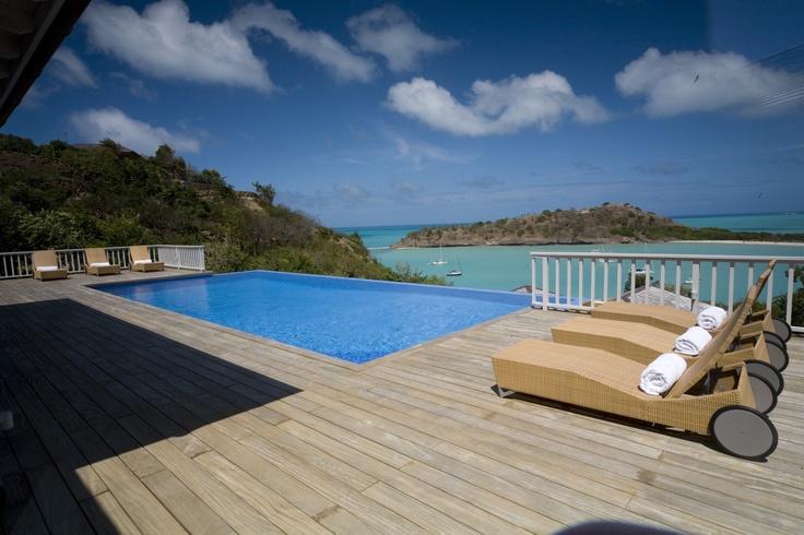 Sunbathing by the pool of Capri luxury villa in Antigua, Caribbean