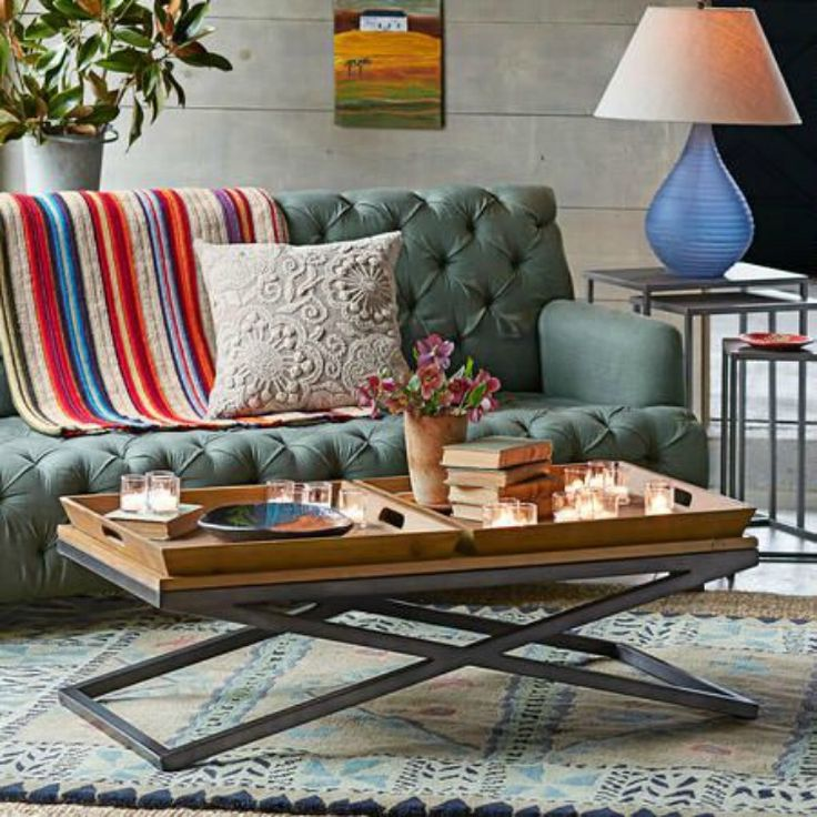 Versatile serving tray coffee table with two removable wooden trays.