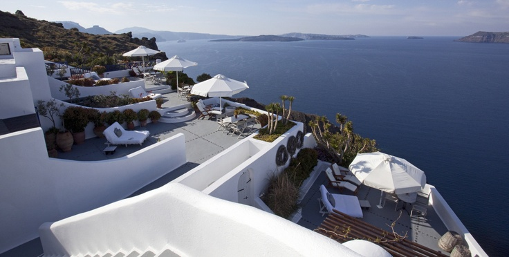 Perfect terraces for lounging and relaxing on one's holiday or honeymoon!  IKIES, Oia, Santorini, Greece