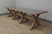 The Sawbuck Table - A solid worn oak trestle table inspired by the honest construction of a C19th American sawbuck. Solid oak and wrapped zinc tops are also available.  Available to order in bespoke sizes.
