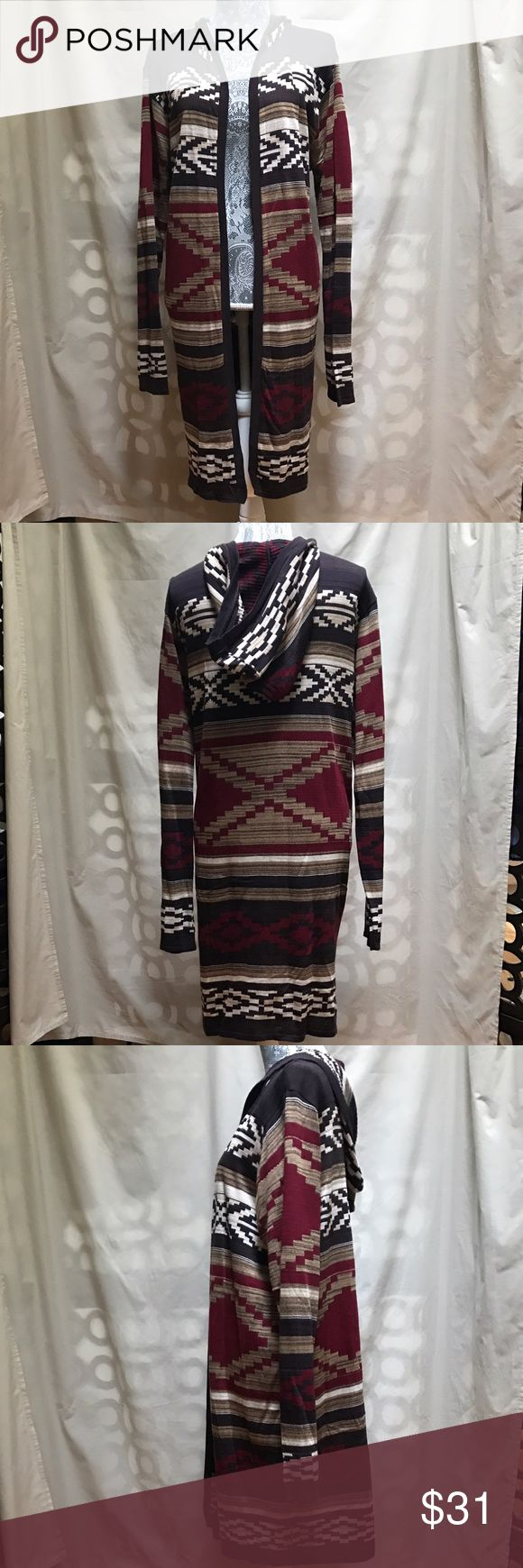CENY Women's Tribal Print Long Knit Cardigan 3X CENY Women's Brown Tribal Print Long Hooded Sweater Knit Cardigan Shrug 3X. This is a warm, cozy long sleeve, hooded sweater which looks great with jeans and boots. EUC, no rips tears odors or stains. CENY Sweaters Cardigans