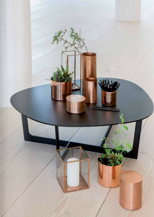 arrangements like this with assorted copper vases, plants/succulents, and add in some white (flowers or vases or both)