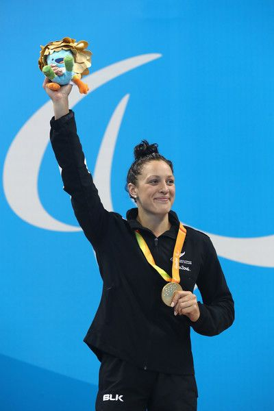 Gold medalist Sophie Pascoe of New Zealand celebrates on the podium at the medal ceremony for the Women's 100m Backstroke - S10 Final on day 3 of the Rio 2016 Paralympic Games at the Olympic Aquatic Stadium on September 10, 2016 in Rio de Janeiro, Brazil.