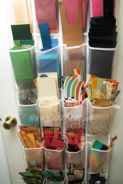 using an over the door organizer to manage all your scraps courtesy of  http://craftstorageideas.com/paper-scraps-storage/