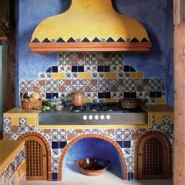 Traditional elements were used in this Mexican hacienda's newly restored cocina, including decorative tile work and a concrete venting hood.
