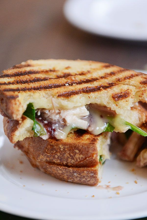 The absolute best way to use Thanksgiving leftovers, this turkey and brie panini with cranberry and spinach will be one of your all-time favorite sandwiches!!